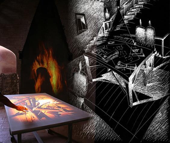 Tavolo con proiezione interattiva e disegno del progetto del museo